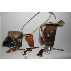Collection of 3 cap guns and leather holsters