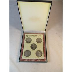 Set of Morgan Dollars in Case 1873, 1889, 1891, 1900, 1921