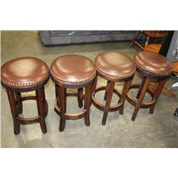 FOUR STUDDED LEATHER STOOLS