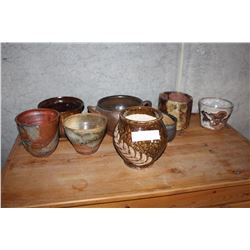 EIGHT DECORATIVE POTTERY PLANT POTS