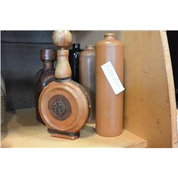 THREE STONEWARE LIQUOR BOTTLES AND TWO LEATHER BOTTLES