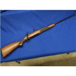 Winchester 70 Rifle- .300 Rem Ultra Mag- Deluxe Model- Bolt Action- Scope Rings- #G357409
