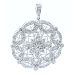 18K WHITE GOLD DIAMOND PENDANT:6.13 GRAMS/DIAMOND:0.69CT