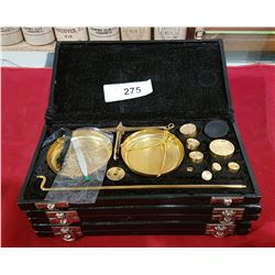 THREE CASED GOLD SCALES