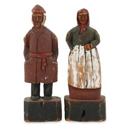 Pair of Carved Figures by McNiven