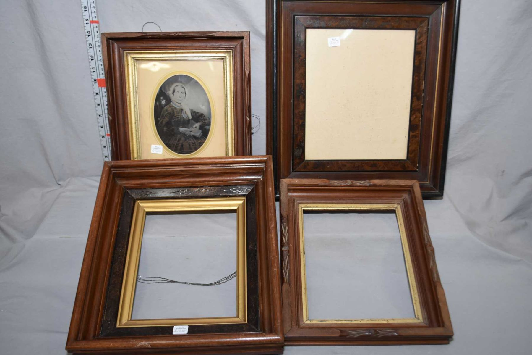 Four vintage wood frames, a tin type photo and framed Charles Godrey ...