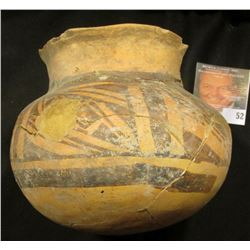"""Partially restored Clay Pot with black diagonal marking on brown clay.  Museum number on base """"2207"""""""