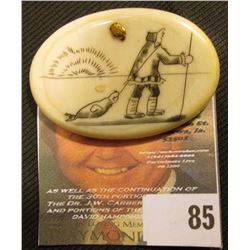 Hand carved Ivory Pin back with attached Gold Nugget. Depicts an Eskimo dragging a seal with an atta