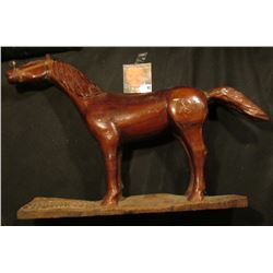 """Wooden Horse with copper wire bridle and a few nicks and chips, carved in base """"1945 Hand Carved By"""