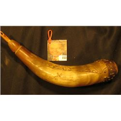 Old Powder Horn with wood plug, and butt cobb, with brass hob nails. Horn is engraved with a pair of
