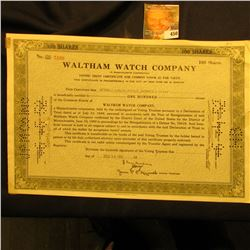 "November 14, 1951 Stock Certificate for 100 Shares ""Waltham Watch Company"", hole cancelled."