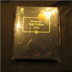 Whitman Coin Album for Kennedy Half Dollars, pages are out of order, near Mint condition.