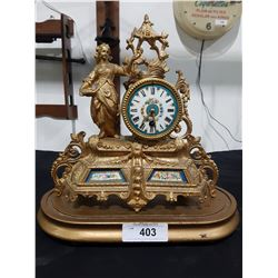ANTIQUE FRENCH FIGURAL GILT MANTLE CLOCK