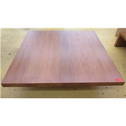 "Oversized Square Wooden Table, 5ft X 5ft, 15"" H, one side has approx. 1/4"" dent along top edge"