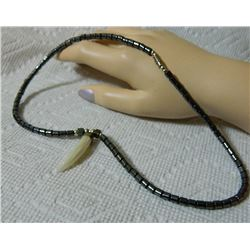 ESTATE - NECKLACE - HEMITITE WITH ABALONE? HORN HORN 6.9mm diameter at top 34mm long