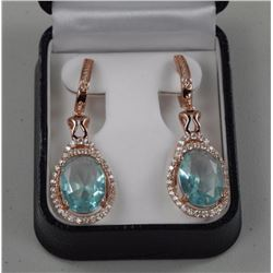 Ladies .925 Silver Earrings. 2 Prong, Topaz blue O