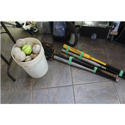 PAIL OF SOFTBALLS AND GLOVE AND BATS