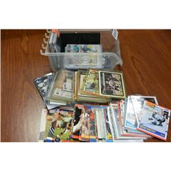 SMALL TRAY OF SPORTS CARDS AND PHONE