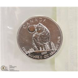2011 CANADIAN WOLF 1 OZ SILVER COIN.