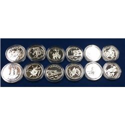 Canada Lot of 12 Commemorative Silver 50 Cent Coins in Capsules