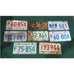 EIGHT VINTAGE LICENSE PLATES