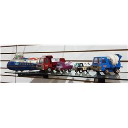 FOUR VINTAGE BUDDY L TRUCKS & TIN SPACESHIP