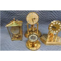 FOUR ANNIVERSARY CLOCKS