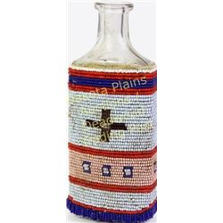Early 20th century beaded buckskin medicine bottle