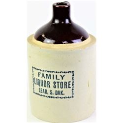 Stoneware advertising whiskey jug