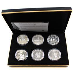 RCM Issue: 1935-1967 The Vintage Canadian Silver Dollar Collection in Black RCM Display Case. This S