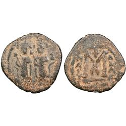 ARAB BYZANTINE: Two Standing Figures, AE Fals (5.45g), Ba'albakk, AD 670-680s. Two figures standing,