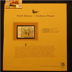 2000 Millenium North Dakota $6.00 State Migratory Waterfowl Stamp, mounted in a plastic page with li