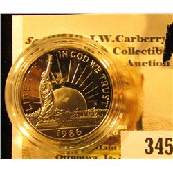 1986 S Proof Statue of Liberty Commemorative Half Dollar in a sealed cointain holder.