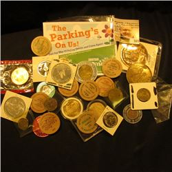 Nice Group of encased Coins, Medals, Tokens, & Wooden Nickels. At least one in original U.S. Mint ce