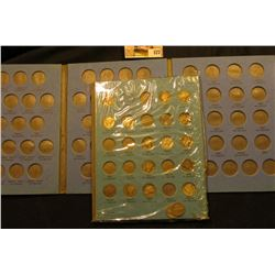 Empty used Jefferson Nickel Whitman folder; & a partial set of 1916 up Mercury Dimes in a blue Whitm