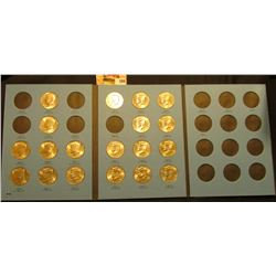 1986-1987 Partial Set of Kennedy Half Dollars in a blue Whitman coin folder. (19 pcs.) Most are BU.