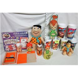 Flinstone lot - 1993 Rub and color set. Assorted plush dolls. Coffee cup & baby bottle.