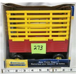 NEW 1:16 2009 New Holland NH bale throw wagon. Die cast steel & plastic.