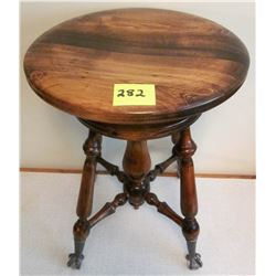 vintage claw foot/marble wooden piano stool. Adjustable.