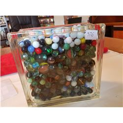 huge glass container of marbles