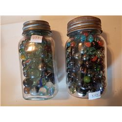 2 jars of marbles lots of large size