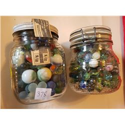 2 jars of marbles lots of mini. Some rare and some large.