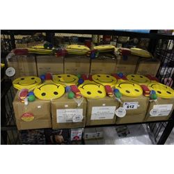 SHELF LOT CONTAINING 11 BOXES OF SMILEY FACE PADDLE BALL GAME