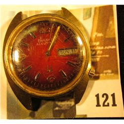 Bulova Accutron 218 wristwatch, red face, day/ date model, N4 on case (1974 manufacture date), needs