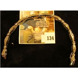 Sterling and CZ bracelet, features round and baguette CZs, 7  long closed, marked 925, 14.0 g / 9.0