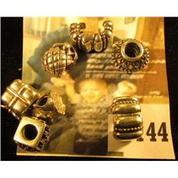(7) sterling Pandora bracelet charms, includes a ghost, a 4 seasons block, a pineapple, a wrapped pr