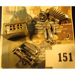 (4) assorted sterling charms – a cabin, a cactus, an Indian headdress and a typewriter. Sounds like