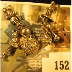 (4) assorted sterling charms – a heart, a leprechaun with pot behind his back, a nurse with a servin