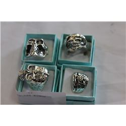 LOT OF FOUR STAINLESS RINGS