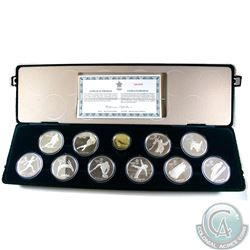 Complete 1988 Calgary Olympic Sterling Silver 10-Coin Set with 14K $100 Gold Coin in the Original Di